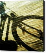 Shadow Of A Person Riding A Bicycle Canvas Print by Sami Sarkis