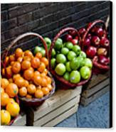 Six Baskets Of Assorted Fresh Fruit Canvas Print by Todd Gipstein