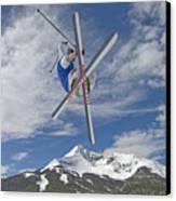 Skiing Aerial Maneuvers Off A Jump Canvas Print by Gordon Wiltsie