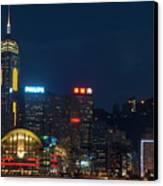 Skyline Illuminated At Night From Kowloon Canvas Print by Sami Sarkis