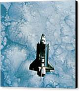 Space Shuttle Orbiting Above Earth Canvas Print
