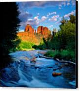 Stormlight On Red Rock Crossing Canvas Print by Kerrick James