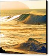 Sunset Surfers Canvas Print by Kevin Smith