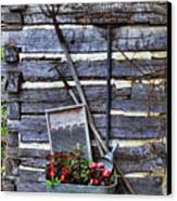 Tall Log Cabin And Garden Tools Canvas Print by Linda Phelps