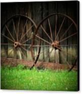 Two Wagon Wheels Canvas Print by Michael L Kimble