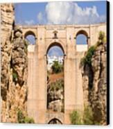 View Of The Tajo De Ronda And The Puente Nuevo Bridge From Across The Valley Canvas Print