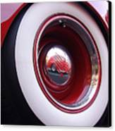 Wheel Reflection Canvas Print by Carol Milisen