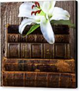 White Lily On Antique Books Canvas Print by Garry Gay