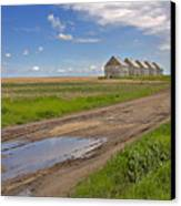 White Sheds On A Prairie Farm In Spring Canvas Print