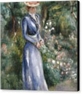 Woman In A Blue Dress Standing In The Garden At Saint-cloud Canvas Print by Pierre Auguste Renoir