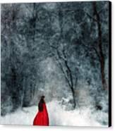 Woman In Red Cape Walking In Snowy Woods Canvas Print by Jill Battaglia