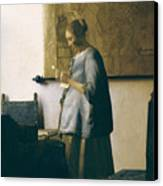 Woman Reading A Letter Canvas Print by Jan Vermeer