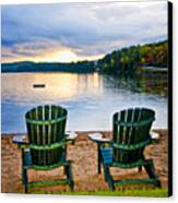 Wooden Chairs At Sunset On Beach Canvas Print