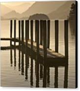 Wooden Dock In The Lake At Sunset Canvas Print by John Short