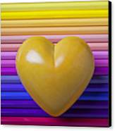 Yellow Heart On Row Of Colored Pencils Canvas Print