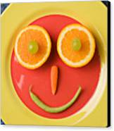 Yellow Plate With Food Face Canvas Print