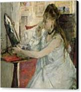 Young Woman Powdering Her Face Canvas Print