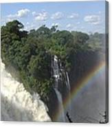 Mist And Rainbow At Victoria Falls Canvas Print