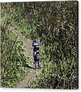 2 Photographers Walking Through Tall Grass Canvas Print