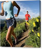 A Couple Trail Running Canvas Print