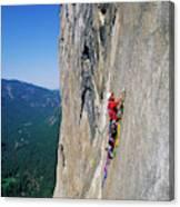 A Man Aid Climbing Canvas Print