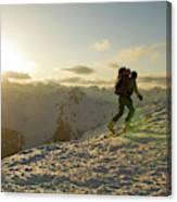A Man Backcountry Skiing At Sunset Canvas Print
