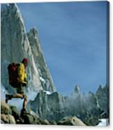 A Man Backpacks In Front Of Fitz Roy Canvas Print