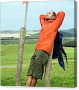 A Man Enjoying A Moment Of Rest Canvas Print
