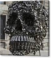 A Skull Sculpture Made Of Cans And Metal Along The Grand Canal Canvas Print