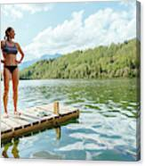 A Woman Is Standing On A Jetty Canvas Print