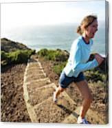 A Woman Running Stairs Near The Ocean Canvas Print