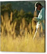 A Young Man Fly-fishing At Sunset Canvas Print