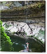 A Young Woman Enjoys The Hamilton Pool Canvas Print