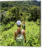A Young Woman Hikes Through The Jungles Canvas Print