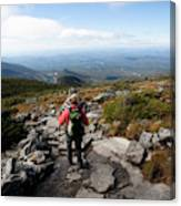 An Athletic Female Hiker Hikes Canvas Print