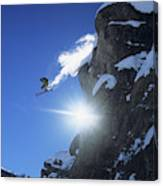 An Extreme Skier Jumps Off A Snowy Canvas Print