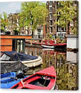 Boats On Canal In Amsterdam Canvas Print
