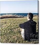 Caucasian Traveler Relaxing On Grass Outdoors Canvas Print