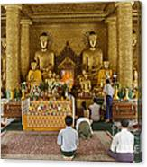 faithful Buddhists praying at Buddha Statues in SHWEDAGON PAGODA Canvas Print