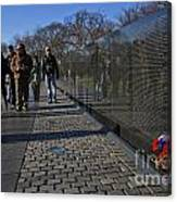 Flowers Left At The Vietnam War Memorial Canvas Print
