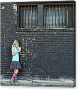 Girl Standing Next To Brick Wall Canvas Print