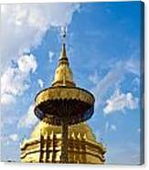 Golden Pagoda With Blue Sky At Wat Phra That Hariphunchai Canvas Print