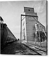 grain elevator and old train track with grain railcars leader Saskatchewan Canada Canvas Print