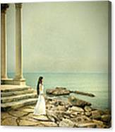 Lady In White By The Sea Canvas Print