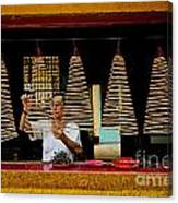 Man Lighting Incense In Chinese Temple Vietnam Canvas Print