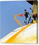 Man Throwing Orange Paint On Boudhanath Stupa Canvas Print