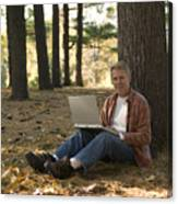 Man Using Laptop Outdoor Canvas Print