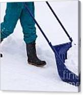 Manual Snow Removal With Snow Scoop After Blizzard Canvas Print