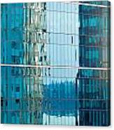 Reflections In Modern Glass-walled Building Facade Canvas Print