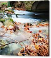 River Flowing Under Stone Bridge Canvas Print